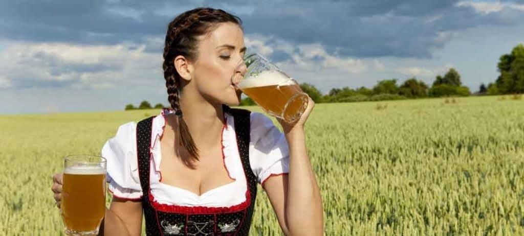 pauly girl drinking beer in fields
